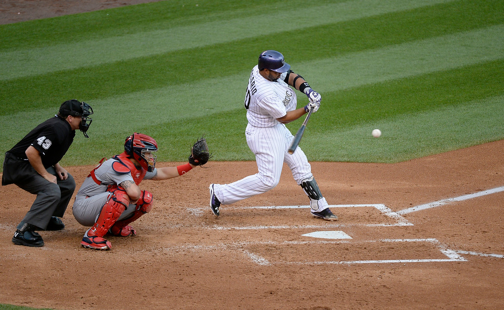 . DENVER, CO - JUNE 24: Colorado Rockies catcher Wilin Rosario (20) hits a double to center field in the third inning against the St. Louis Cardinals June 24, 2014 at Coors Field. (Photo by John Leyba/The Denver Post)