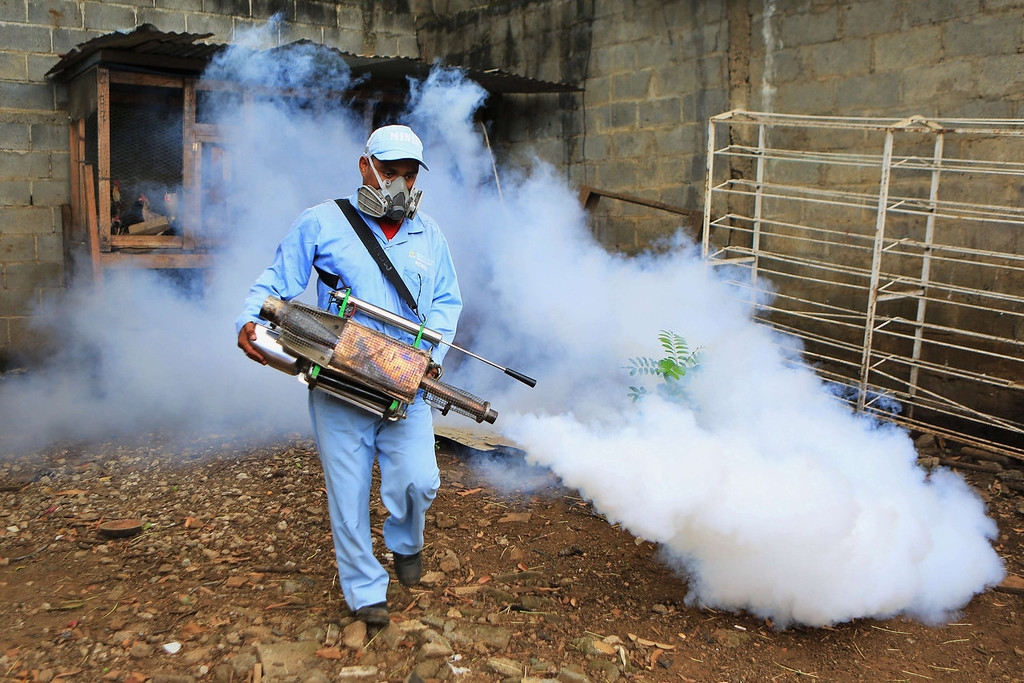 . A member of the Health Ministry fumigates a home against the Aedes aegypti mosquito to prevent the spread of dengue fever in Managua, on October 25, 2013. The Nicaraguan government issued a health red alert as a dengue fever epidemic has killed 13 people so far this year - six in the past week - and infected more than 4,000 individuals, according to presidential spokesman Rosario Murillo. Dengue, transmitted by the Aedes aegypti mosquito, occurs in Central America mostly during its rainy season from May to November. The disease causes fever, muscle and joint ache as well as potentially fatal dengue hemorrhagic fever and dengue shock syndrome.   Inti Ocon/AFP/Getty Images