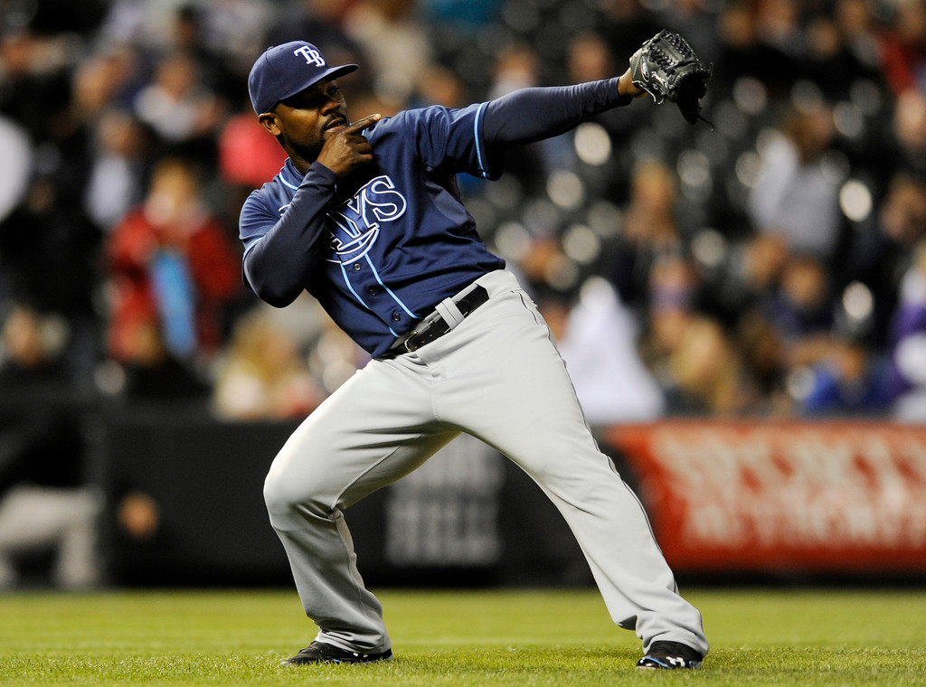 . Tampa Bay Rays relief pitcher Fernando Rodney celebrates an extra innings win against the Colorado Rockies following the 10th inning of a baseball game on Friday, May 3, 2013, in Denver. The Rays beat the Rockies 7-4. (AP Photo/Jack Dempsey)