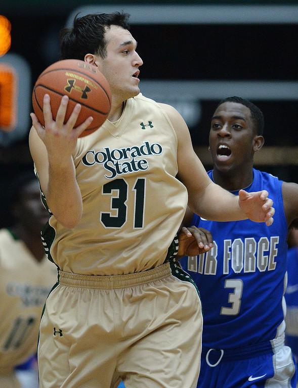 . FORT COLLINS, CO. - JANUARY 18:  Colorado State forward J.J. Avila (31) handled an in-bound pass in front of Falcons\' junior forward Justin Hammonds (3) in the first half. The Colorado State men\'s basketball team hosted Air Force at Moby Arena in Fort Collins Saturday night, January 18, 2014. Photo By Karl Gehring/The Denver Post
