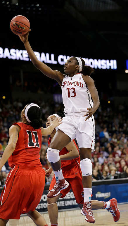 . Stanford\'s Chiney Ogwumike drives past Georgia defenders in the first half of a regional semifinal in the NCAA women\'s college basketball tournament Saturday, March 30, 2013, in Spokane, Wash. (AP Photo/Elaine Thompson)