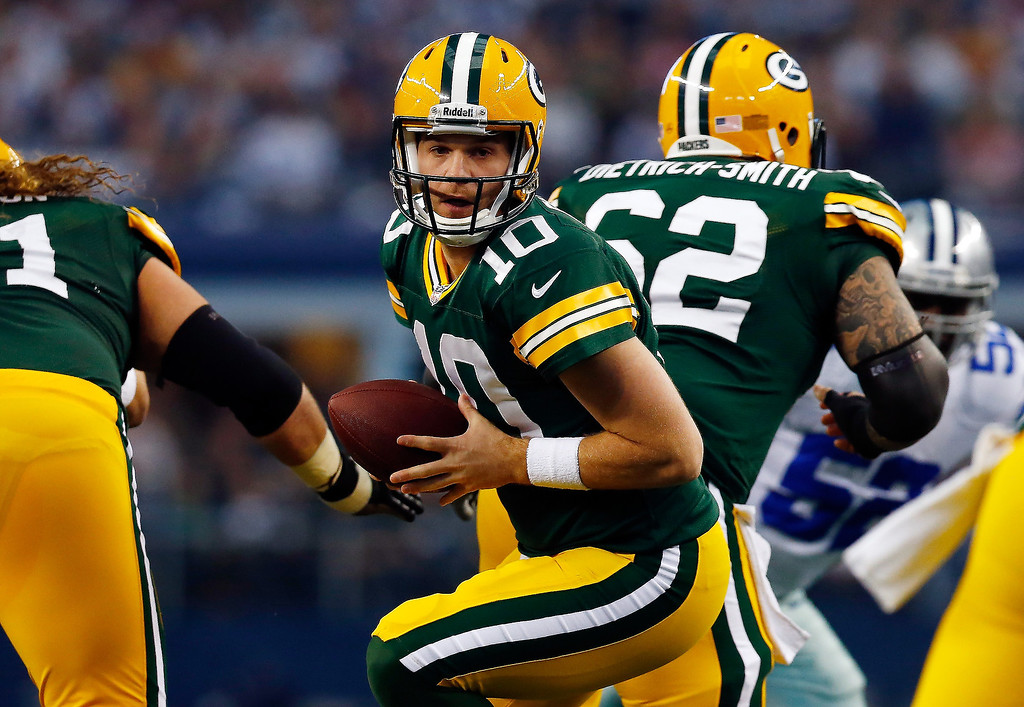 . Quarterback Matt Flynn #10 of the Green Bay Packers drops back against the Dallas Cowboys during a game at AT&T Stadium on December 15, 2013 in Arlington, Texas.  (Photo by Tom Pennington/Getty Images)