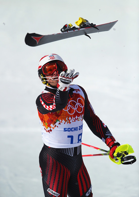 . Natko Zrncic-Dim of Croatia throws his ski in the air during the Alpine Skiing Men\'s Super Combined Downhill on day 7 of the Sochi 2014 Winter Olympics at Rosa Khutor Alpine Center on February 14, 2014 in Sochi, Russia.  (Photo by Clive Rose/Getty Images)