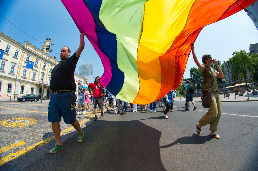 ". People hold a giant ""rainbow\"" flag during the Gay Pride Parade in Ljubljana, Slovenia, on June 15, 2013. AFP PHOTO / JURE  Makovec/AFP/Getty Images"