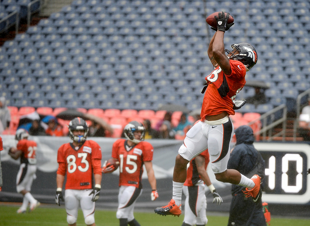 . Denver Broncos wide receiver Demaryius Thomas (88) goes up for a catch in drills during a rain day on day six of the Denver Broncos 2014 training camp July 30, 2014 at Sports Authority Field at Mile High Stadium.  (Photo by John Leyba/The Denver Post)