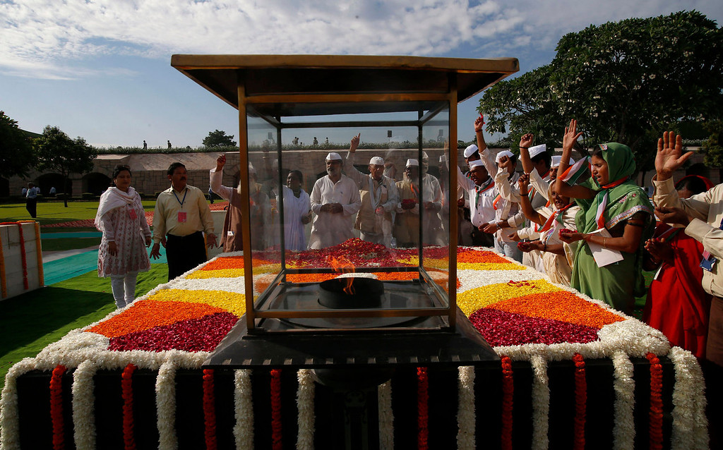 . People offer their prayers at a memorial of  Mahatma Gandhi on the occasion of his birth anniversary, in New Delhi, India, Wednesday, Oct. 2, 2013. (AP Photo/Saurabh Das)