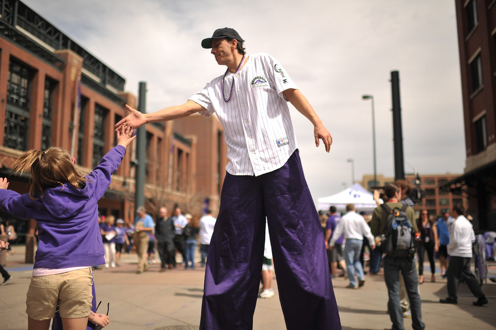 ". Gary Carnes, ""Shorty\"", wears stilts and interacts with fans before the gates open to Coors Field. The Colorado Rockies took on the San Diego Padres on Opening Day at Coors Field in Denver, Colorado. (Photo by Hyoung Chang/The Denver Post)"