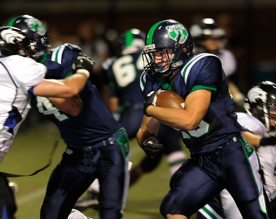 . HIGHLANDS RANCH, CO. - SEPTEMBER 13: Grizzlies\' running back Matt Stanley (4) took the ball up the middle in the second quarter. The ThunderRidge High School football team hosted Grandview at Shea Stadium Friday night, September 13, 2013.  Photo By Karl Gehring/The Denver Post