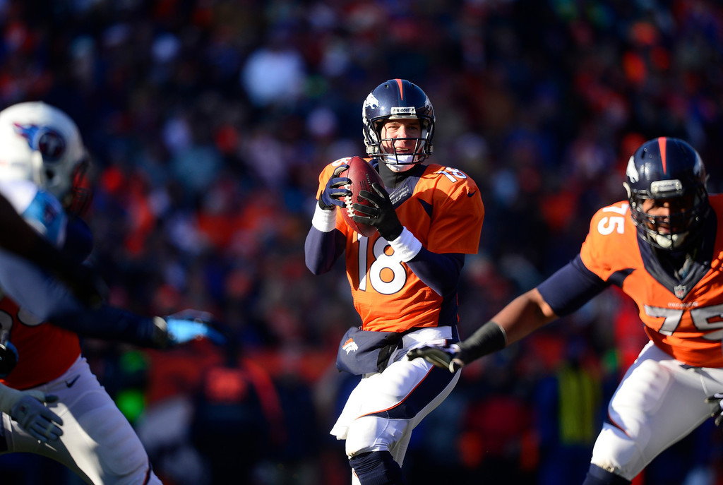. Denver Broncos quarterback Peyton Manning (18) looks to pass in the first quarter against the Tennessee Titans on December 8, 2013. (Photo by AAron Ontiveroz/The Denver Post)