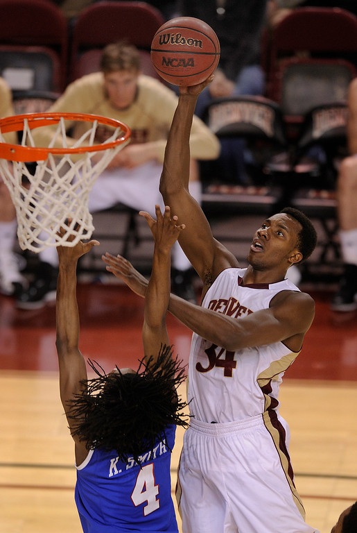 . Denver forward Chris Udofia (34) challenged Bulldogs defender Kenneth Smith (4) at the hoop in the second half. The University of Denver men\'s basketball team defeated the Louisiana Tech Bulldogs 78-54 at Magness Arena Saturday night, March 9, 2013. (Photo By Karl Gehring/The Denver Post)