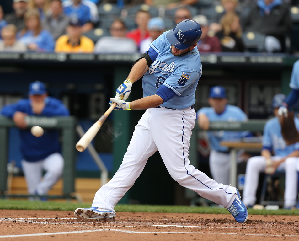 . KANSAS CITY, MO - MAY 14:  Mike Moustakas #8 of the Kansas City Royals hits a three run double in the second inning against the Colorado Rockies at Kauffman Stadium on May 14, 2014 in Kansas City, Missouri. (Photo by Ed Zurga/Getty Images)
