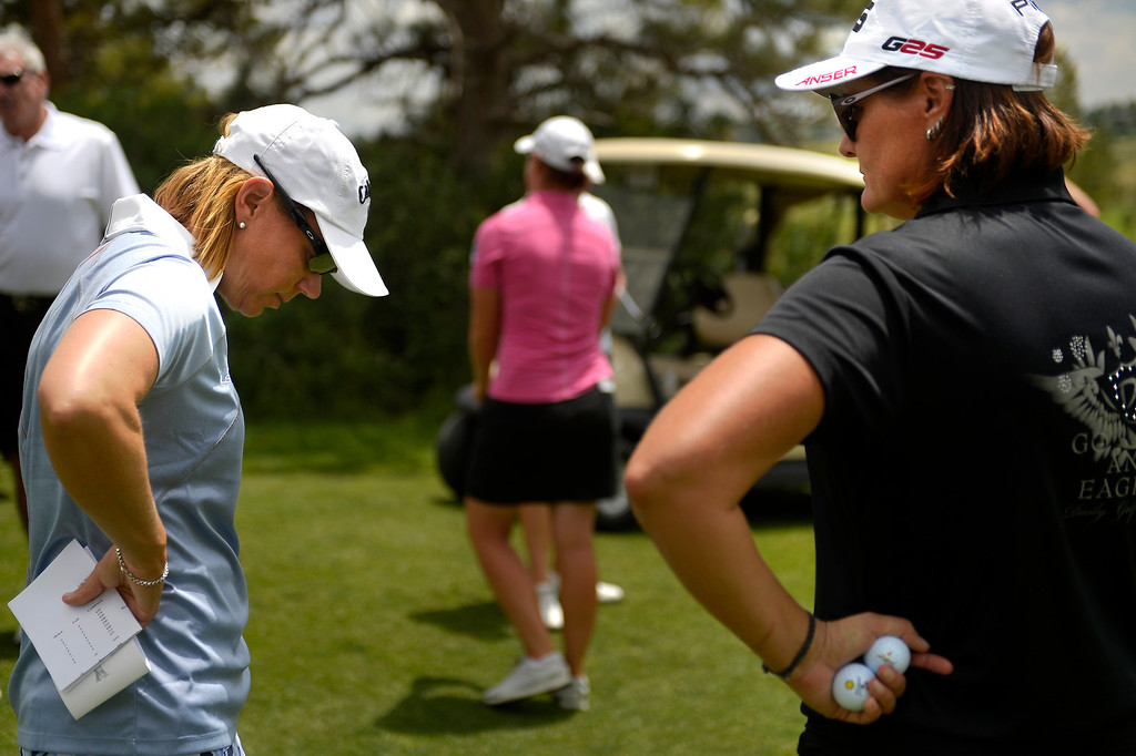 . Vice captain Annika Sörenstam talks with Maria Hjorth,  representing Sweden, on the 2013 European Solheim Cup Team while looking at the first 9 holes of the course at Colorado Golf Club in Parker, Colorado. (Photo By Joe Amon/The Denver Post)
