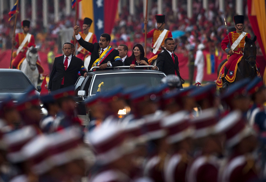 . Venezuela\'s newly inaugurated President Nicolas Maduro waves (L) during a motorcade after his installation in Caracas on April 19, 2013   Ronaldo Schemidt/AFP/Getty Images