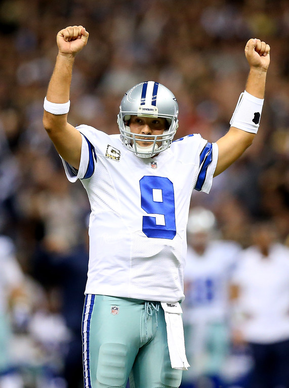 . Quarterback Tony Romo #9 of the Dallas Cowboys celebrates a touchdown in the second quarter against the New Orleans Saints during a game at the Mercedes-Benz Superdome on November 10, 2013 in New Orleans, Louisiana.  (Photo by Ronald Martinez/Getty Images)