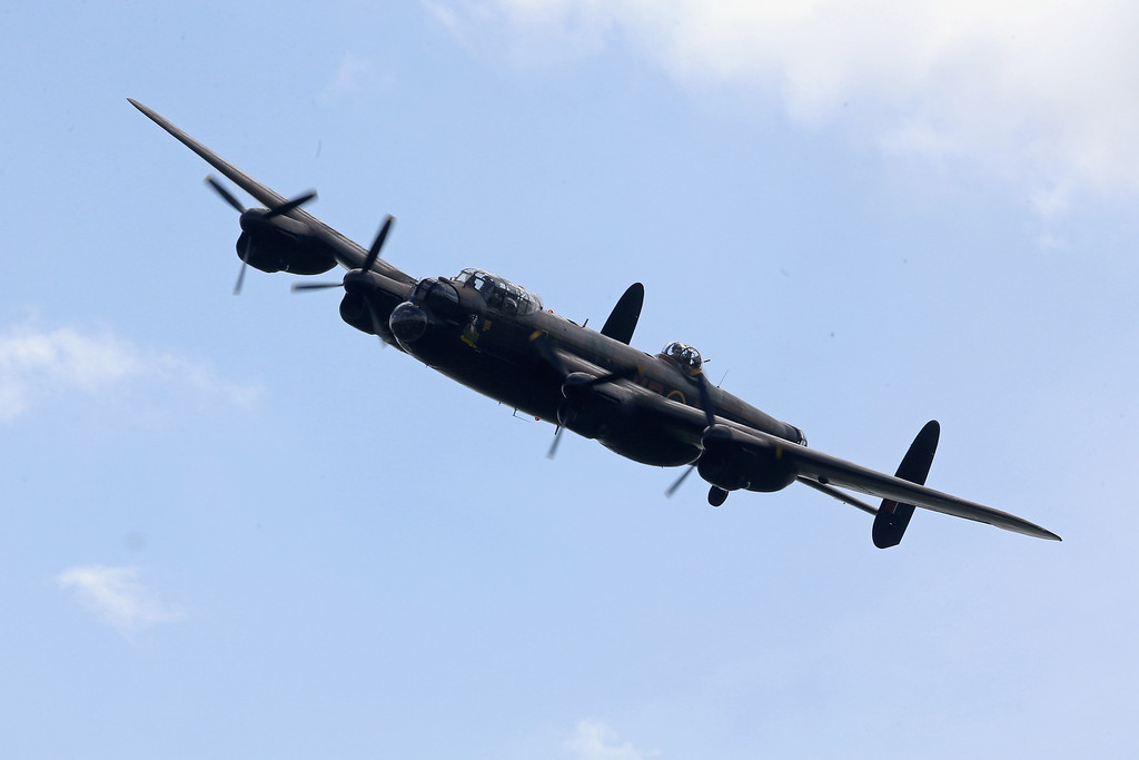 . A Lancaster flies over Pegasus Bridge (also known as the Bénouville Bridge) during D-Day 70 Commemorations on June 5, 2014 in Ranville, France.  (Photo by Chris Jackson/Getty Images)