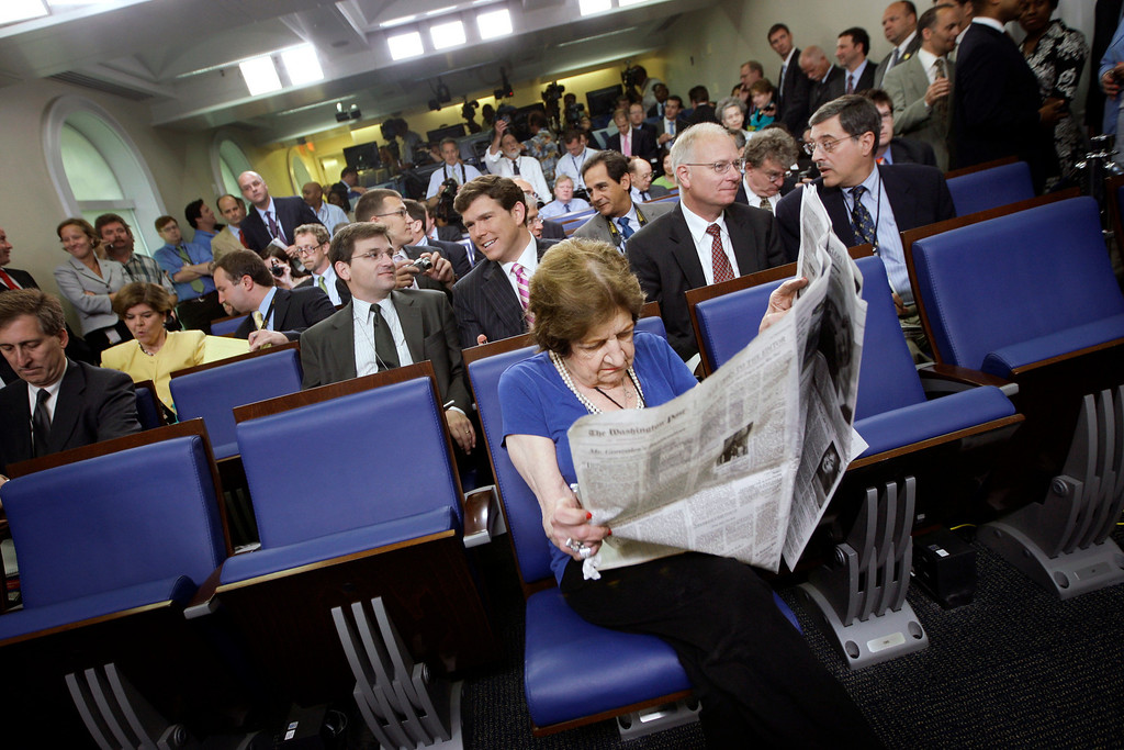 . In this July 11, 2007, file photo veteran White House correspondent Helen Thomas, center, from Hearst Newspapers, sits in her assigned center, front row seat before the ribbon-cutting ceremony for the renovated James S. Brady Press Briefing Room at the White House in Washington. Thomas, a pioneer for women in journalism and an irrepressible White House correspondent, has died. She was 92. (AP Photo/Pablo Martinez Monsivais, File)