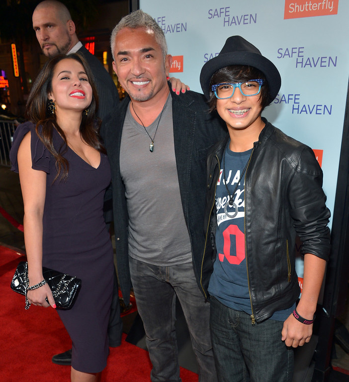 """. Dog Whisperer Cesar Millan (C) and family arrive at the premiere of Relativity Media\'s \""""Safe Haven\"""" at TCL Chinese Theatre on February 5, 2013 in Hollywood, California.  (Photo by Alberto E. Rodriguez/Getty Images for Relativity Media)"""