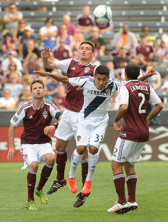 . COMMERCE CITY, CO. - JULY 27:  Rapids defender Shane O\'Neill challenged Galaxy forward Jose Villareal for a header in the first half. The Colorado Rapids hosted the Los Angeles Galaxy Saturday, July 27, 2013.  Photo By Karl Gehring/The Denver Post