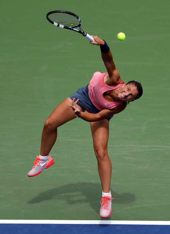 . Sara Errani, of Italy, serves to Flavia Pennetta, of Italy, during the second round of the 2013 U.S. Open tennis tournament, Thursday, Aug. 29, 2013, in New York. (AP Photo/Kathy Willens)