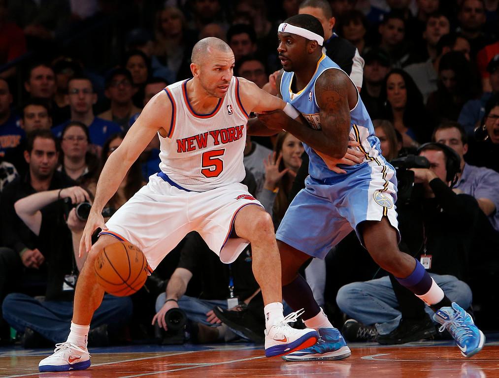 . New York Knicks\' Jason Kidd (5) dribbles against Denver Nuggets\' Ty Lawson during an NBA basketball game, Sunday, Dec. 9, 2012, in New York.  New York beat Denver, 112-106. (AP Photo/Jason DeCrow)