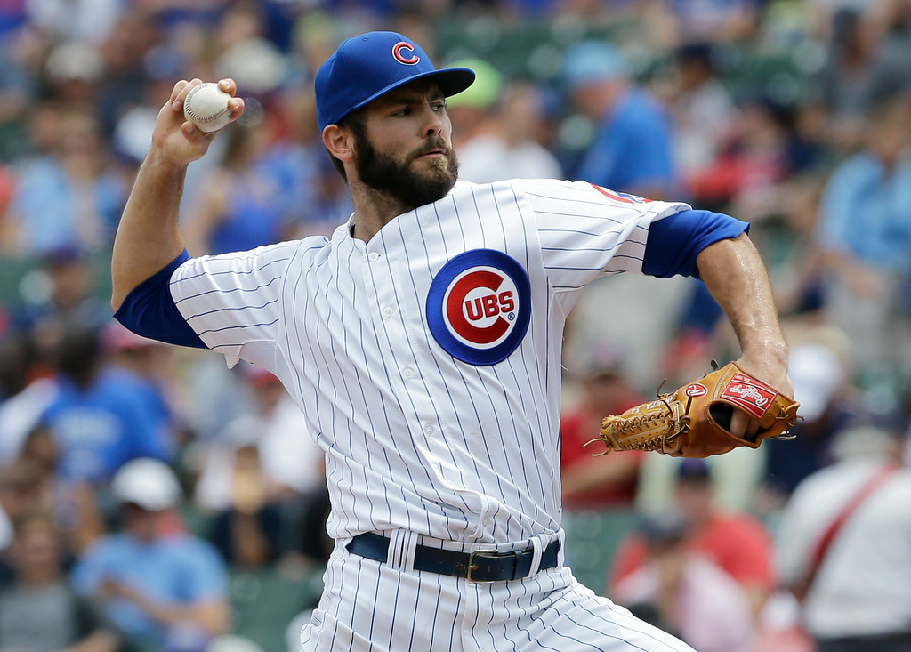 . Chicago Cubs starter Jake Arrieta throws against the Colorado Rockies during the first inning of a baseball game in Chicago, Thursday, July 31, 2014. (AP Photo/Nam Y. Huh)