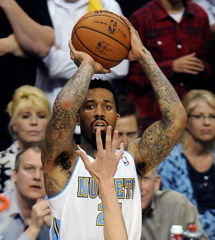 . Denver Nuggets forward Wilson Chandler (21) shoots a three-pointer over Golden State Warriors guard Klay Thompson (11) in the first quarter. The Denver Nuggets took on the Golden State Warriors in Game 5 of the Western Conference First Round Series at the Pepsi Center in Denver, Colo. on April 30, 2013. (Photo by Steve Nehf/The Denver Post)