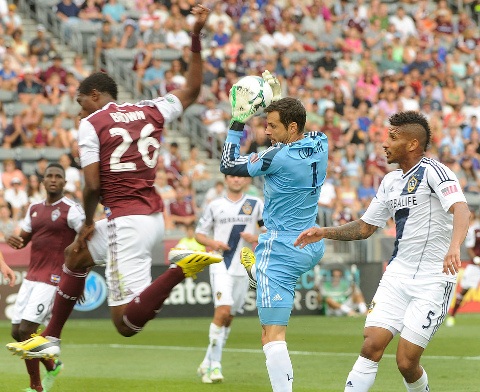 . COMMERCE CITY, CO. - JULY 27:  Galaxy goalkeeper Carlo Cudicini took an opportunity away from Rapids midfielder Deshorn Brown (26) in the first half. The Colorado Rapids hosted the Los Angeles Galaxy Saturday, July 27, 2013.  Photo By Karl Gehring/The Denver Post