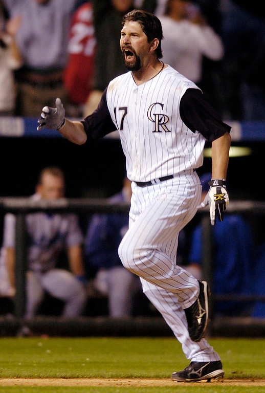 . Todd Helton celebrated his game-winning homerun as he rounded third base after he  hit the ninth-inning dinger off Dodger reliever Takashi Saito.  The Colorado Rockies beat the Los Angeles Dodgers 9-8 in September 2007, at Coors Field in the second game of a doubleheader.     Karl Gehring/The Denver Post