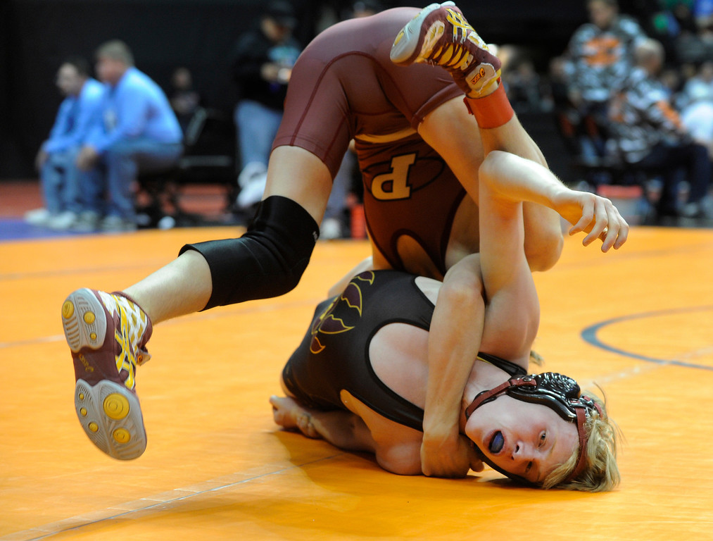 . DENVER, CO. - FEBRUARY 21: Ponderosa High School sophomore Kade Snyder, top, rolled over Rocky Mountain junior Logan Newmann, bottom, during a 113-pound bout in class 5A. The CHSAA State Wrestling Tournament kicked off Thursday, February 21, 2013 at the Pepsi Center in Denver.   (Photo By Karl Gehring/The Denver Post)