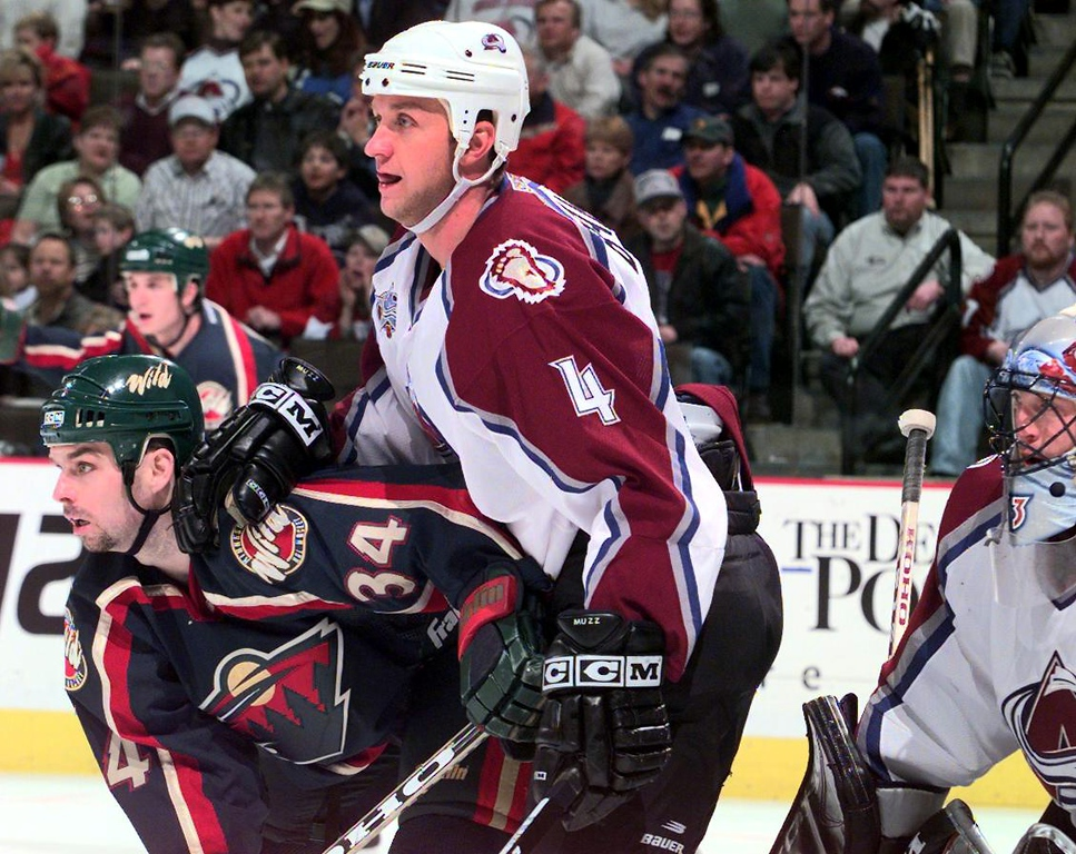 . Rob Blake pushes off on Jim Dowd, #34, in front of Patrick Roy\'s net in the third period of play at Pepsi Center Friday evening.   THE DENVER POST/ ANDY CROSS