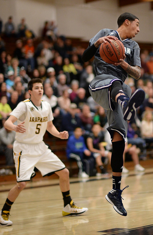 . CENTENNIAL, CO. JANUARY 18: Taren Williams of Overland High School (2) rebound the ball by James Dalrymple of Arapahoe High School (5) in the 1st half of the game at Arapahoe High School. Centennial Colorado. January 18. 2014. Arapahoe won 62-54.  (Photo by Hyoung Chang/The Denver Post)