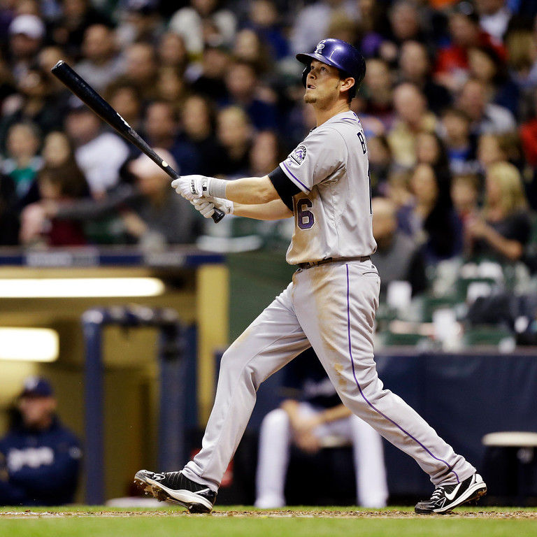 . Colorado Rockies\' Reid Brignac watches his RBI double against the Milwaukee Brewers during the fifth inning of a baseball game, Wednesday, April 3, 2013, in Milwaukee. (AP Photo/Jeffrey Phelps)