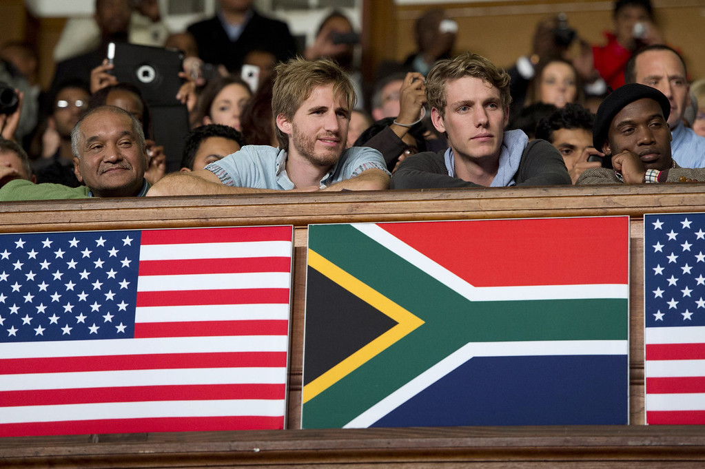 . People listen to US President Barack Obama\'s speech on US - African relations and the younger generation at the University of Cape Town in South Africa on June 30, 2013. Obama made Nelson Mandela the keystone of his address at the University of Cape Town, citing his unifying legacy as a blueprint for a new generation in emerging Africa.  SAUL LOEB/AFP/Getty Images