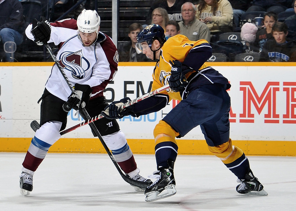 . Ryan O\'Reilly #90 of the Colorado Avalanche skates against Jonathon Blum #7 of the Nashville Predators at the Bridgestone Arena on April 2, 2013 in Nashville, Tennessee.  (Photo by Frederick Breedon/Getty Images)