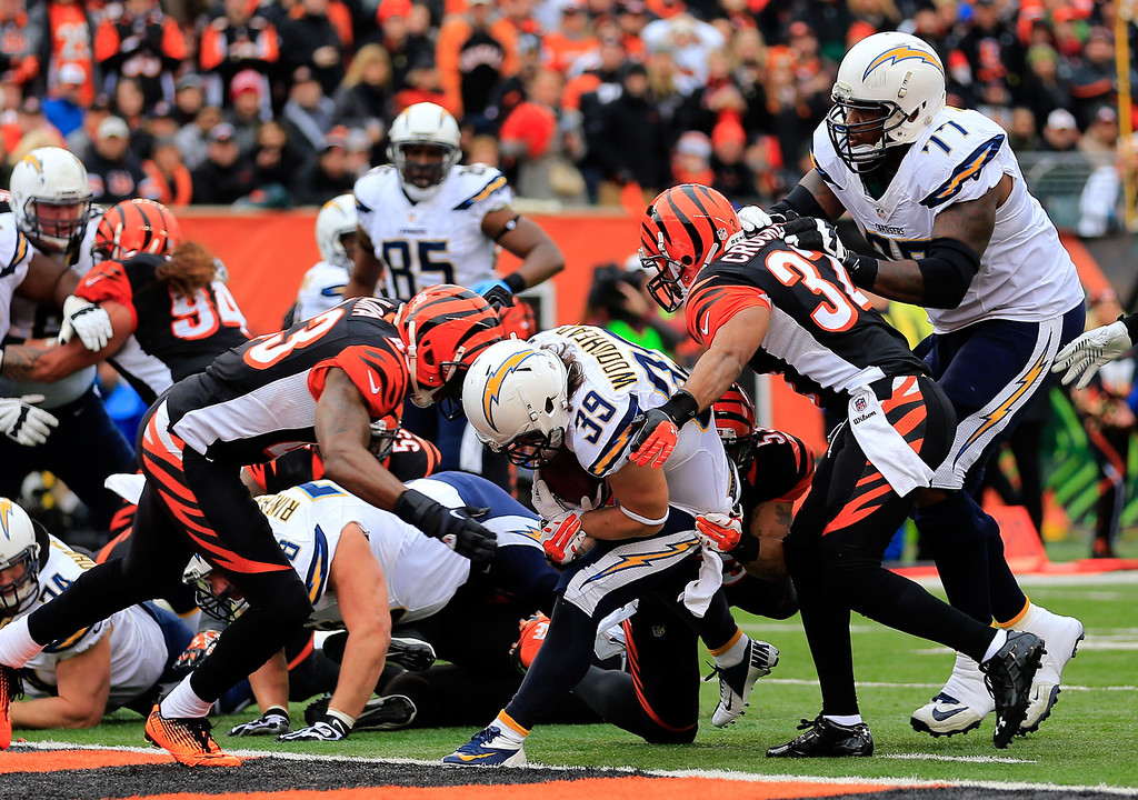 . Running back Danny Woodhead #39 of the San Diego Chargers scores a first quarter touchdown against the Cincinnati Bengals during a Wild Card Playoff game at Paul Brown Stadium on January 5, 2014 in Cincinnati, Ohio.  (Photo by Rob Carr/Getty Images)