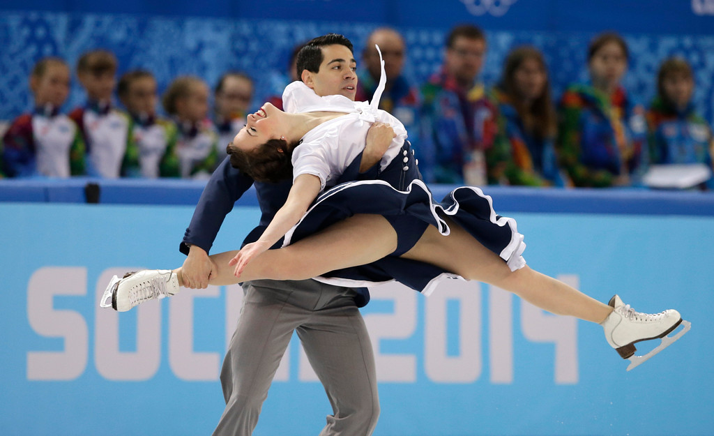 . Anna Cappellini and Luca Lanotte of Italy compete in the ice dance short dance figure skating competition at the Iceberg Skating Palace during the 2014 Winter Olympics, Sunday, Feb. 16, 2014, in Sochi, Russia. (AP Photo/Darron Cummings)