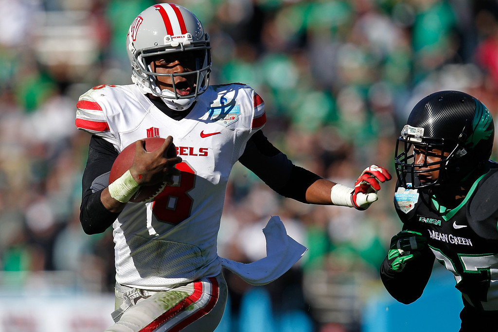 . DALLAS, TX - JANUARY 01:  Caleb Herring #8 of the UNLV Rebels runs against the North Texas Mean Green during the Heart of Dallas Bowl at Cotton Bowl Stadium on January 1, 2014 in Dallas, Texas.  (Photo by Sarah Glenn/Getty Images)