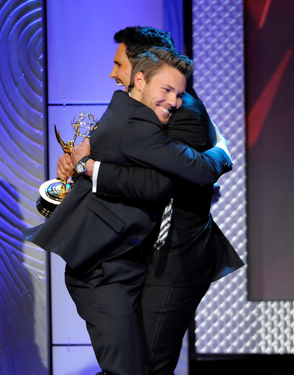 ". Scott Clifton, left, from the cast of ""The Bold and the Beautiful,\"" is congratulated by Don Diamont, after Clifton won the award for outstanding supporting actor in a drama series at the 40th Annual Daytime Emmy Awards on Sunday, June 16, 2013, in Beverly Hills, Calif. Don Diamont presented the award. (Photo by Chris Pizzello/Invision/AP)"