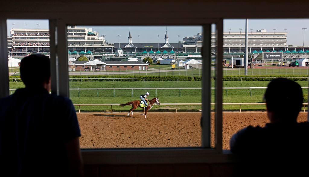 . Exercise rider Emerson Chavez rides Kentucky Derby hopeful Golden Soul for a workout at Churchill Downs Wednesday, May 1, 2013, in Louisville, Ky. (AP Photo/David Goldman)