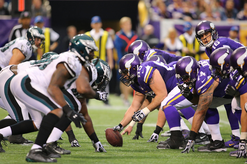 . Center John Sullivan #65 of the Minnesota Vikings prepares to snap the ball to Matt Cassel #16 during a game against the Philadelphia Eagles on December 15, 2013 at Mall of America Field at the Hubert H. Humphrey Metrodome in Minneapolis, Minnesota. (Photo by Adam Bettcher/Getty Images)