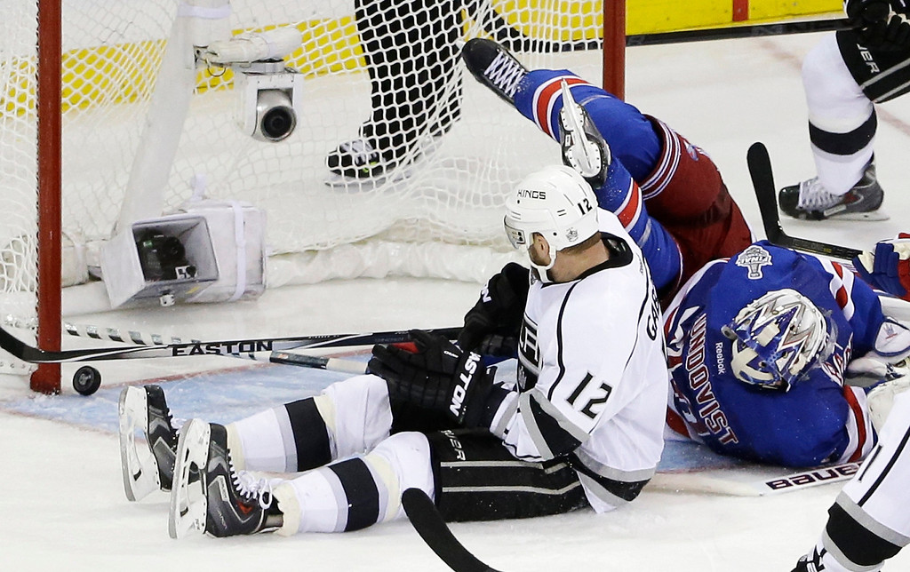 . Los Angeles Kings right wing Marian Gaborik (12) watches as the puck rolls near the goal  with New York Rangers goalie Henrik Lundqvist (30) out of position in the third period during Game 3 of the NHL hockey Stanley Cup Final, Monday, June 9, 2014, in New York. The Kings won 3-0. (AP Photo/Frank Franklin II)