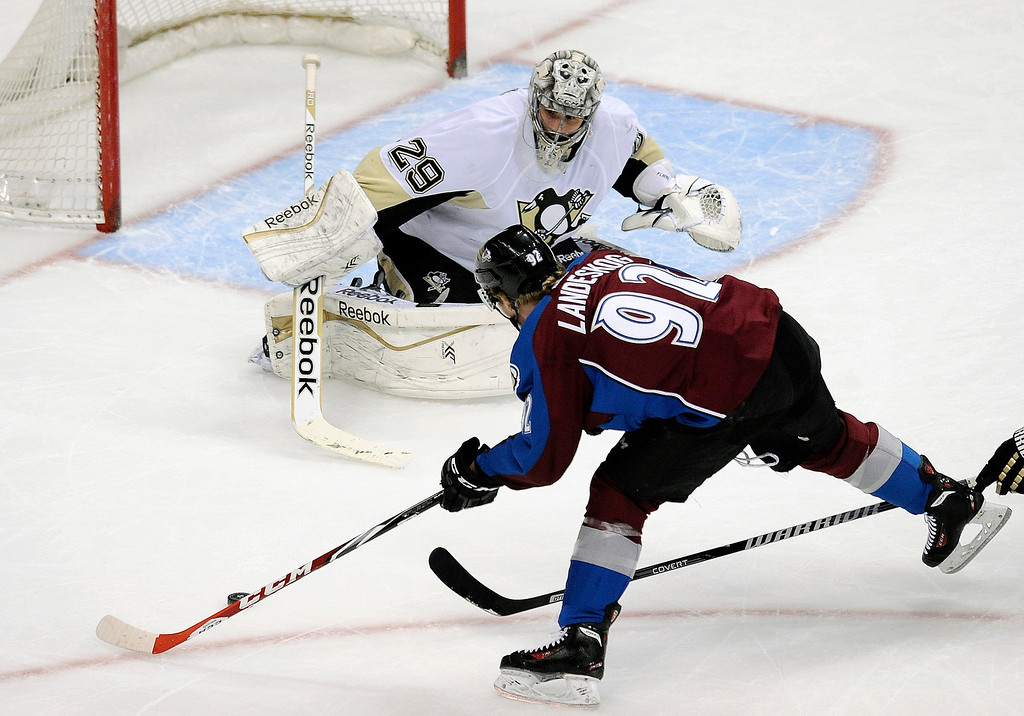 . Colorado Avalanche left wing Gabriel Landeskog, of Sweden, shoots against Pittsburgh Penguins goalie Marc-Andre Fleury during the first period of an NHL hockey game on Sunday, April 6, 2014, in Denver. The Penguins won 3-2 in a shootout. (AP Photo/Chris Schneider)