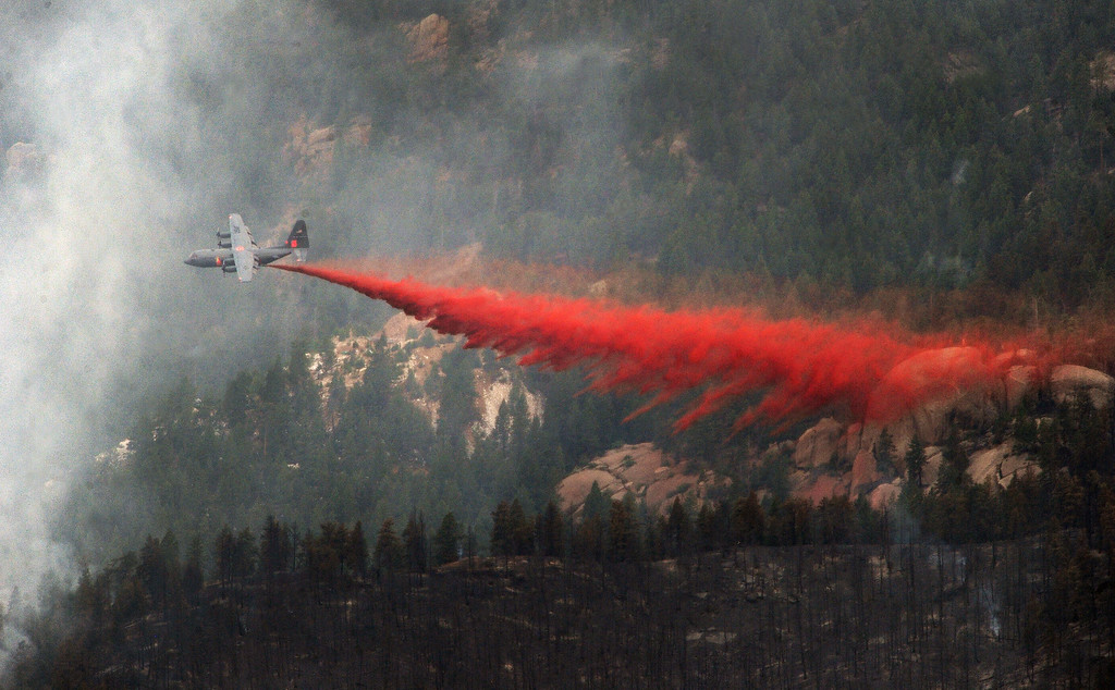 . JEFFERSON COUNTY, CO - JUNE 20:  A slurry bomber makes a late afternoon drop of slurry on the Lime Gulch Fire near Conifer, CO on June 20, 2013.   The Lime Gulch Fire which is burning off of Foxton Road near Conifer, CO continues to burn almost next to last year\'s Lower North Fork fire on June 20, 2013.  Kuehster Road is where many homes burned in the Lower North Fork Fire in March of 2012.  Photo by Helen H. Richardson/The Denver Post)