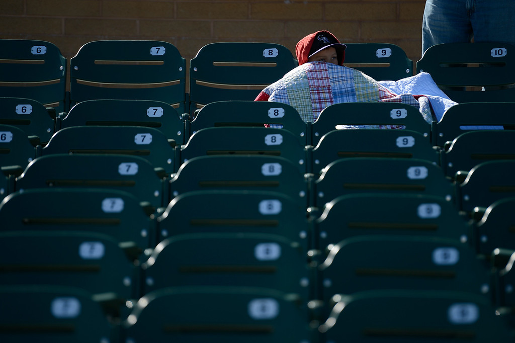 . SCOTTSDALE, AZ. - FEBRUARY 24: Houston Nasser 8-years-old keeps warm under a blanket as he attends the Colorado Rockies Arizona Diamondbacks game February 24, 2013 in Scottsdale. (Photo By John Leyba/The Denver Post)
