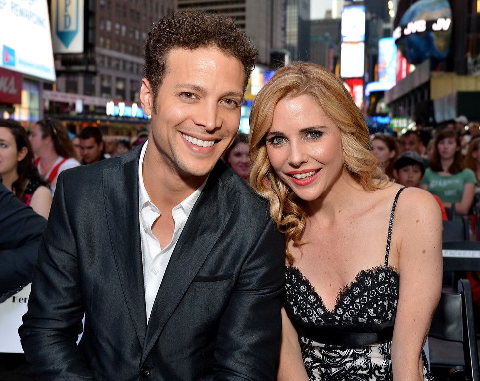 . Hosts Justin Guarini (L) and Kelly Butler pose on stage during the 68th Annual Tony Awards Times Square Simulcast at Times Square on June 8, 2014 in New York City.  (Photo by Slaven Vlasic/Getty Images for Tony Awards Productions)