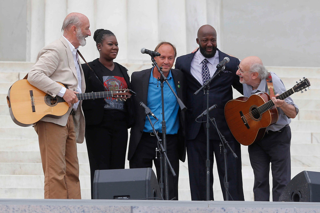 . With Trayvon Martin parents, Sybrina Fulton, and Tracy Martin, and Mark Barden, father of Sandy Hook Elementary School shooting victim Daniel Barden, Peter Yarrow, left, and Paul Stookey, right, of the folk trio Peter, Paul and Mary, perform at the 50th Anniversary of the March on Washington where Martin Luther King, Jr., spoke, Wednesday, Aug. 28, 2013, in front of the Lincoln Memorial in Washington.  (AP Photo/Charles Dharapak)