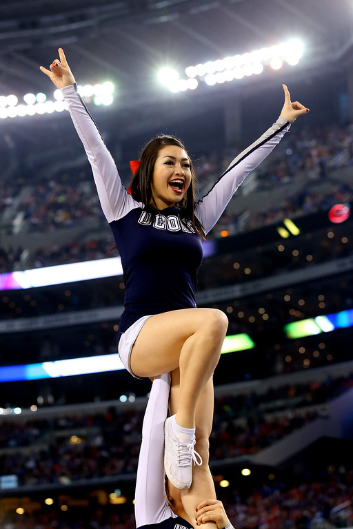 . ARLINGTON, TX - APRIL 05: A Connecticut Huskies cheelreader performs during the NCAA Men\'s Final Four Semifinal against the Florida Gators at AT&T Stadium on April 5, 2014 in Arlington, Texas.  (Photo by Ronald Martinez/Getty Images)