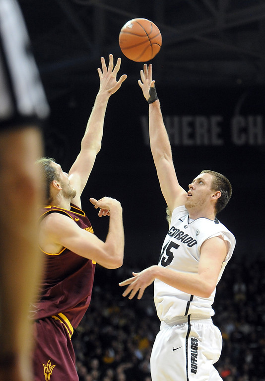 . Shane Harris-Tunks shoots a sky hook on Jordan Bachynski of ASU during the first half of the February 16th, 2013 game in Boulder. Cliff Grassmick / February 16, 2013