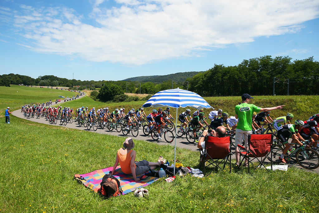 . Fans roadside enjoy the atmosphere as the peloton passes by during the eleventh stage of the 2014 Tour de France, a 188km stage between Besancon and Oyonnax, on July 16, 2014 in Besancon, France.  (Photo by Bryn Lennon/Getty Images)