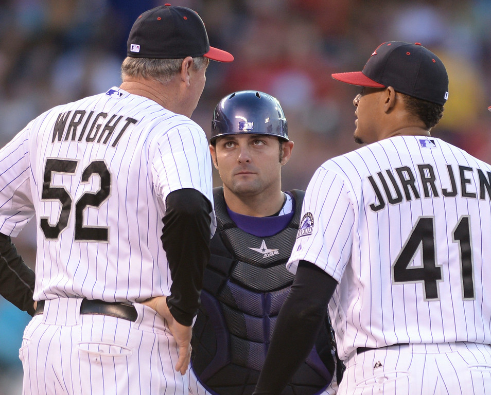. DENVER, CO - JULY 4: Catcher Michael McKenry, center, and starter Jair Jurrjens, right, listened to Colorado pitching coach Jim Wright during a visit to the mound in the fifth inning. The Colorado Rockies hosted the Los Angeles Dodgers at Coors Field Friday night, July 4, 2014.  Photo by Karl Gehring/The Denver Post